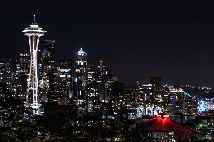 Seattle Space Needle and Skyline Glow at Night