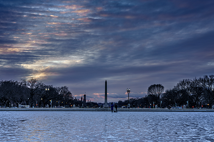Vivid Pink Cloudy Sunset above Washington Monument and Icy Capitol Reflecting Pool