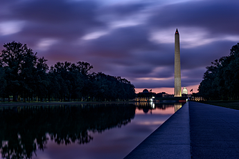 The National Mall turns purple with the rising sun