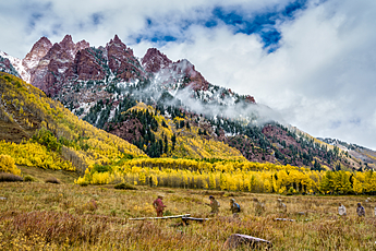 Ghost Hikers and Fall Colors beneath Wintry Peaks near Maroon Bells