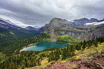Grinnell Lake and Falls in Glacier National Park under Rain Clouds
