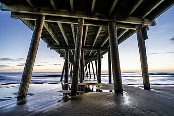 Watching Sunrise under the Pier at Virginia Beach