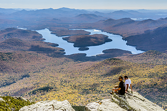 Hikers behold Lake Placid from atop Whiteface Mountain